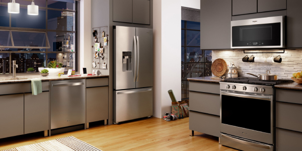 An Image of Modern, bright, clean, kitchen interior with stainless steel appliances in a luxury house.