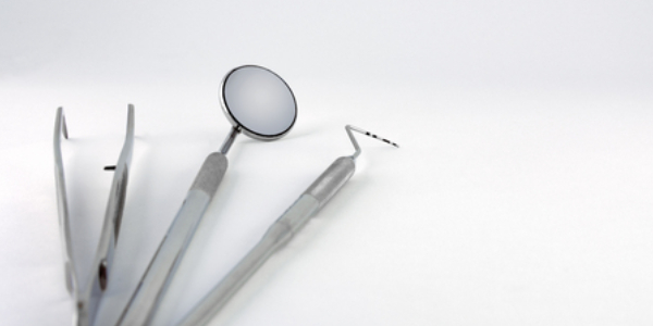 Stainless Steel Surgical Instruments Isolated On White Background Representing Dental Surgery Concept.